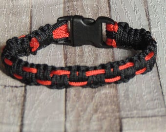 Mens bracelet sports black and red graphic effect macrame