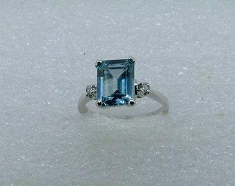 Blue Topaz, diamond and gold ring-Emerald cut genuine Topaz in 9 carat white gold