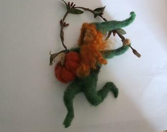Garden gnome with magical pumpkin