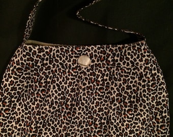 """15""""x 12"""" Buttercup Bag in leopard print cotton. Tan brushed cotton lining with two inner pockets and magnetic snap closure. 12"""" strap."""
