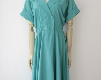 Vintage teal green 80s dress. 80s teal blue dress. 80s midi dress. colorblock dress. Midi shirt dress