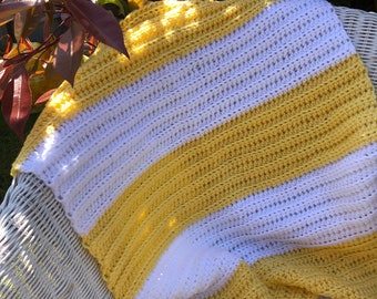 Yellow and white hand crochet baby blanket.