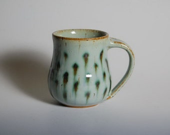 Pottery mug with green dots
