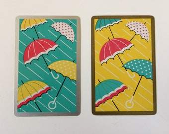 Pair of swap cards red yellow green umbrellas