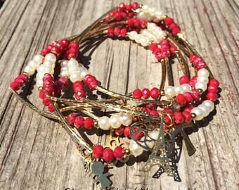 Pearl and Red shimmer Beaded Bracelets with gold plated charms - Semanario de piedritas de perla y rojas tornasol con dijes de chapa de oro