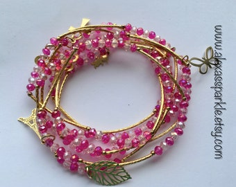 Crystal Clear and Pink beaded bracelet set (7) with gold plated charms - Seminario pulseras cristal y rosa con dijes de chapa de oro