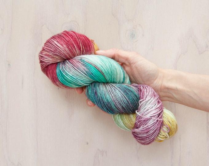 Hand dyed yarn, merino yarn, nylon yarn, sock yarn, hand dyed sock yarn, variegated yarn, pink yarn, yellow yarn, blue yarn, rainbow yarn