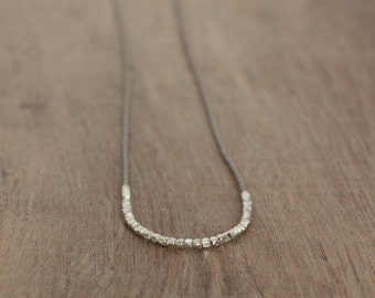 Delicate necklace with tiny sterling silver beads on a Silk cord.