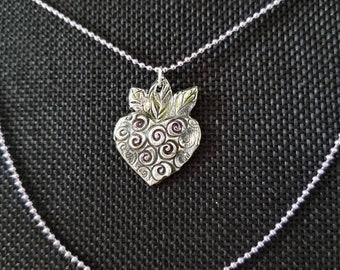 Heart in turmoil artisan fine silver pendant dangles from faded purple ball chain