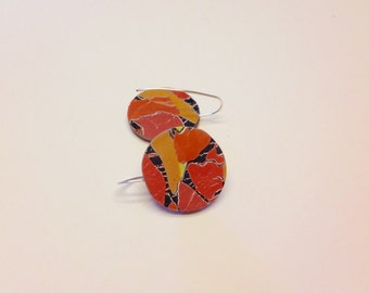 Orange, gold, black and white collage earrings.