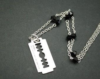 Silver tone razor blade beaded necklace