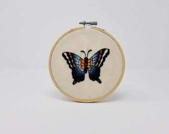 blue and orange swallowtail butterfly embroidery