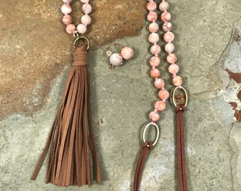 Leather tassle pendant on a jasper and leather necklace with matching earrings