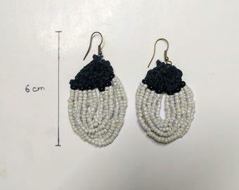 White beaded earrings with crochet work