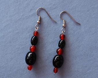 Black beads, red beads, silver fish hook earrings