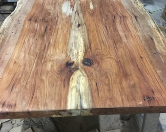 Live edge bookmatched repurposed dining table. Truly one of a kind special