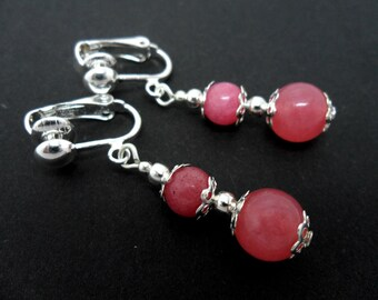 A pair of pretty pink  jade   dangly clip on earrings.