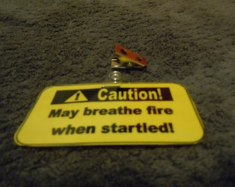 "Caution badge - ""May breathe fire when startled!"""