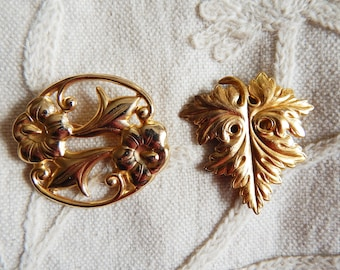 A Vintage Goldtone Leaf Dress Clip and a Later Art Nouveau Inspired Vintage Brooch