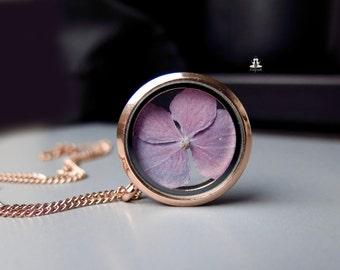 Rosé gold stainless steel locket with a real hydrangea inside