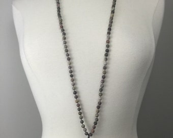 Hand knotted beaded necklace with soldered arrowhead