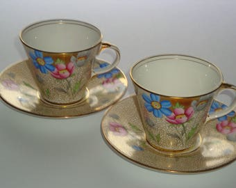 Pair of Hand Painted Cosmos Bouquet Art Deco Aynsley Tea Cup and Saucer Set