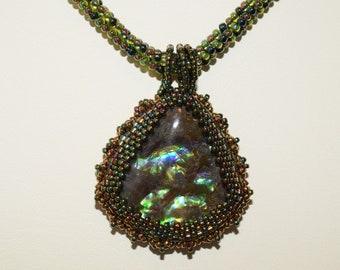 Fossil Ammolite handbeaded cabochon and necklace. (E1077)