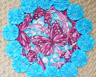 """12"""" Blue and Mauve/Lavender Stained Glass Butterfly Print Yo Yo Doily"""