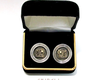 Age of Industry cuff links blend the bold simplicity of Art Deco and the intricate musings of Steampunk, sterling silver & 14k gold