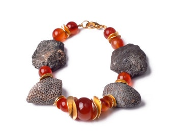 A bracelet of fossilised coral and carnelian