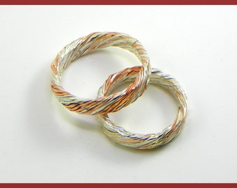 Pair of wedding or engagement rings.