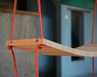 Flexible wooden swing for indoor