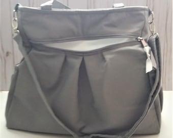 Gray backpack diaper bag with waterproof lining, gray convertible bag