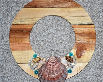 The Lion's Paw shell is a beautiful center piece to the display. This beach theme would work in a number of decor settings.