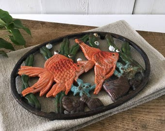 Cast iron oval trivet. French vintage nautical decor cast iron trivet, fish seashell algae design. French country kitchen. French seaside
