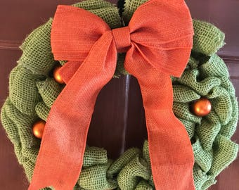 Green and orange Halloween wreaths