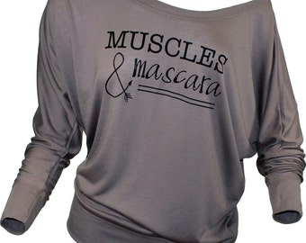 Muscles and mascara long sleeved mocha slouchy tee. Girly shirt. Slouchy top. Mascara shirt. Womens off the shoulder slouchy. Muscle shirt.