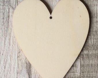pack of 10 unpainted laser cut traditional shaped hearts with a choice of one hole, two holes, no holes or slits