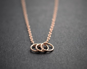 Ring rose gold necklace. Minimalist ring necklace. three rings rose gold necklace. rose gold filled chain. pease. Pease jewelry