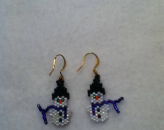 These are tiny hand beaded snowmen earrings.