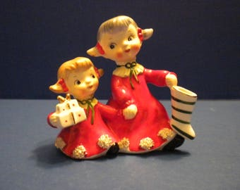 Norcrest Sisters Christmas Figurine One with Present and One with Stocking