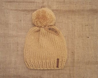 Pighouse adult chunky knit handmade butterscotch cosy winter bobble hat with extra large pom pom. Vegan Friendly.