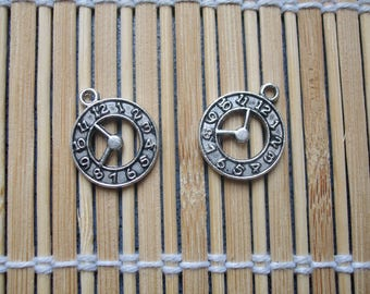 2 charms shown in silver