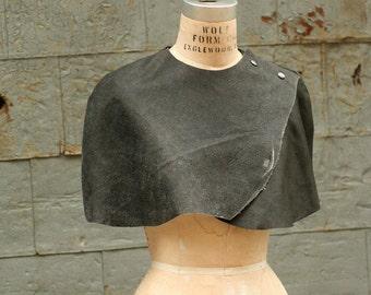 Caplet Leather, black cape, distressed black leather, womenswear, avantgarde