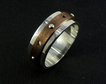 Ring in Sterling silver 925 and copper with studs