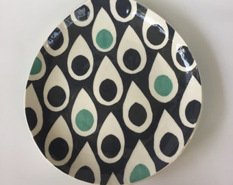 Plate teardtrop shaped with big splash rain drops in bluegreen and charcoal