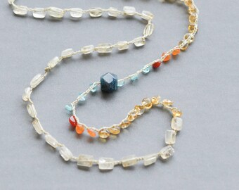 Sunrise necklace in blues and golds with citrine, carnelian, and apatite