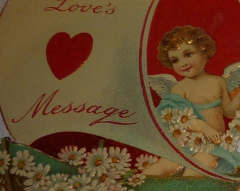Cupid in Sailboat With Chain of Daisies Vintage 1920s Die Cut German Valentine Card