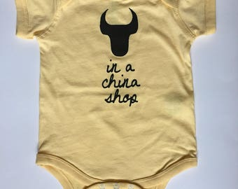 Bull In A China Shop, size: 12 months, baby one-piece, romper, screen printed, yellow with black print