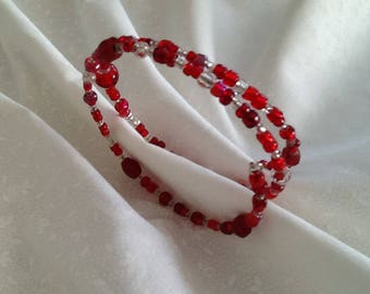 Beaded bracelet made of red and clear glass on memory wire